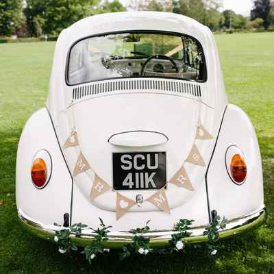 Vintage white wedding transport