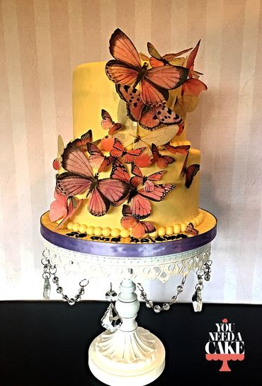 Themed yellow wedding cakes