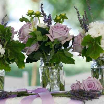 Outdoor purple wedding floral decor