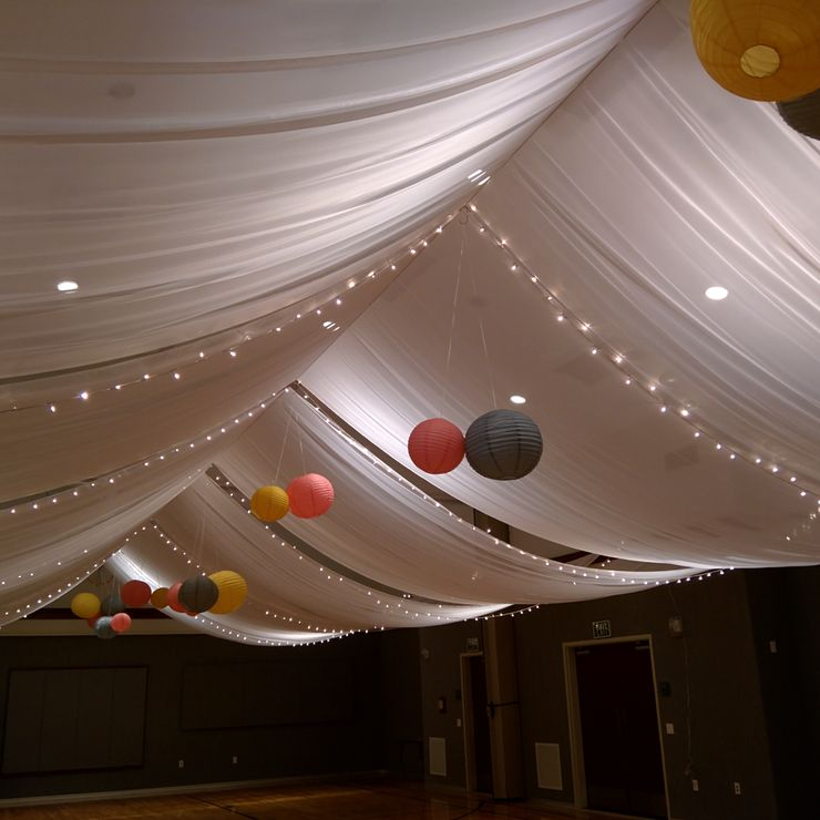 Fabric ceiling drape with lights and paper lanterns