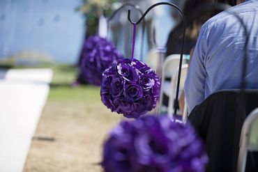 Outdoor purple wedding ceremony decor