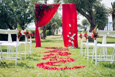 Red outdoor wedding ceremony decor