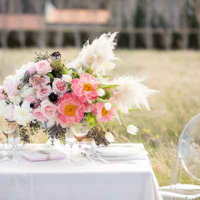 Ivory outdoor wedding floral decor