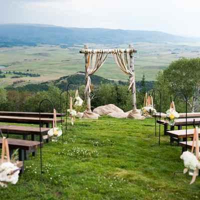 White rustic wedding ceremony decor