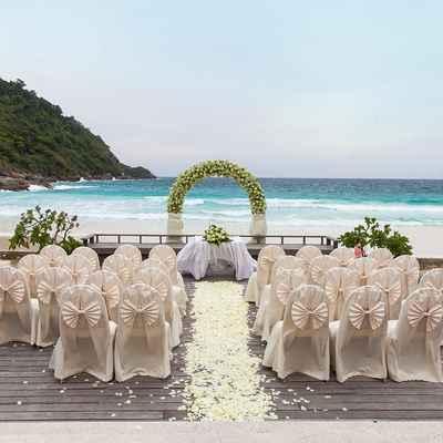 Ivory beach wedding ceremony decor