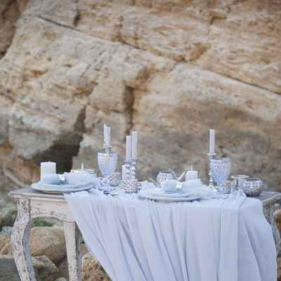 Blue beach wedding photo session decor