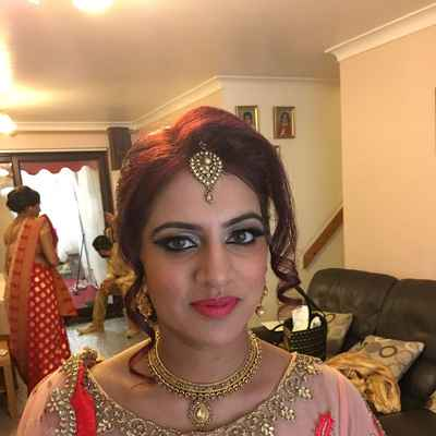 Pink ethnical bridal hair and make-up